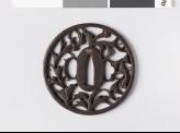Round tsuba with karakusa, or scrolling plant pattern (EAX.10497)