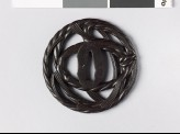 Round tsuba in the form of New Year straw rope (EAX.10514)