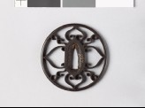 Round tsuba with scrolls and aoi, or hollyhock leaves