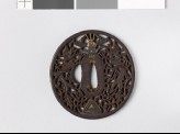 Tsuba with dragons and karakusa, or scrolling plant pattern (EAX.10794)
