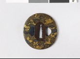 Tsuba with animals and flowers