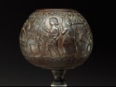 Coconut bowl on stand with procession of figures