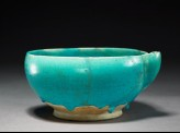 Spouted bowl with undulating waves