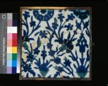 Tile with floral decoration