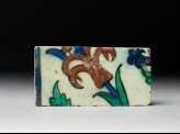 Tile fragment with tulip