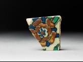 Tile fragment with flower