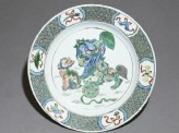 Dish with three lion dogs playing with a ball