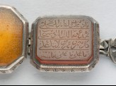 Octagonal bezel amulet from a bracelet, with thuluth inscription (LI1008.15)