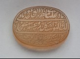 Oval bezel amulet with nasta'liq inscription and floral decoration