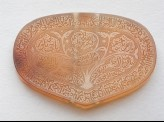 Heart-shaped bezel amulet inscribed with the Throne verse