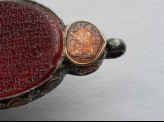 Heart-shaped bezel amulet from a bracelet, with naskhi inscription (LI1008.5)
