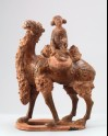 Figure of a camel carrying a young girl