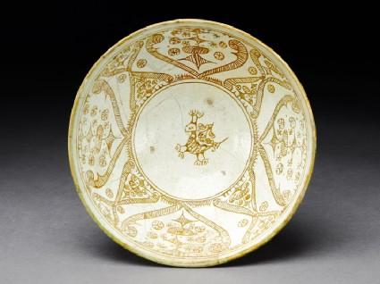 Bowl with stylized bird, scroll decoration, and leavestop