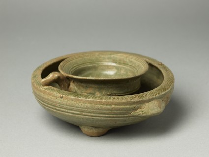 Greenware tripod vessel with inner bowloblique