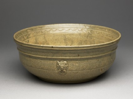 Greenware bowl with bands of decorationoblique