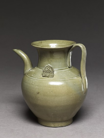 Greenware ewer with ornamental flangesoblique
