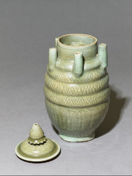 Greenware vase with five spoutsoblique, with lid
