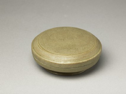 Greenware circular box and lid with floral decorationoblique