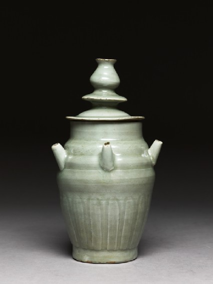 Greenware funerary jar with five spoutsside