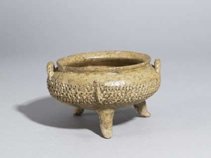 Greenware tripod bowl with impressed decorationoblique