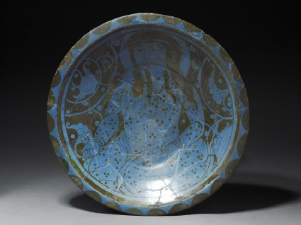 Dish with seated figuretop