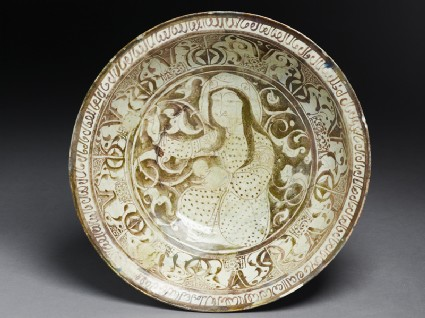 Dish with seated female figure against a foliate backgroundtop