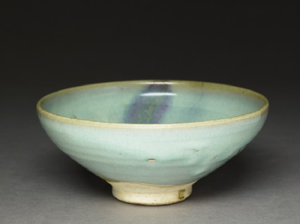Bowl with purple splashoblique
