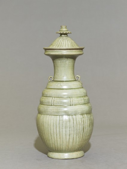 Greenware burial-pot with incised linesside
