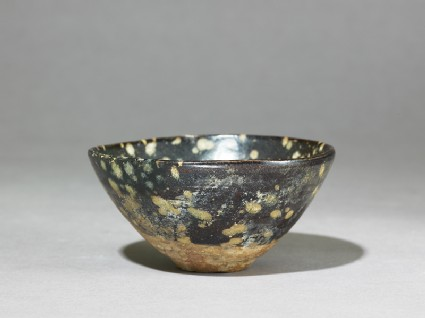 Black ware tea bowl with 'tortoiseshell' glazesoblique