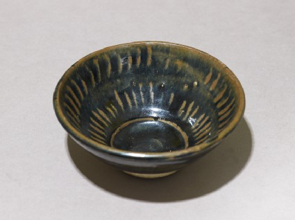 Black ware bowl with stripesoblique