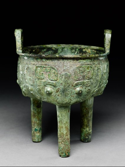 Ritual food vessel, or ding, with dragon and taotie masksoblique