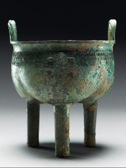 Ritual food vessel, or ding, with taotie masksside
