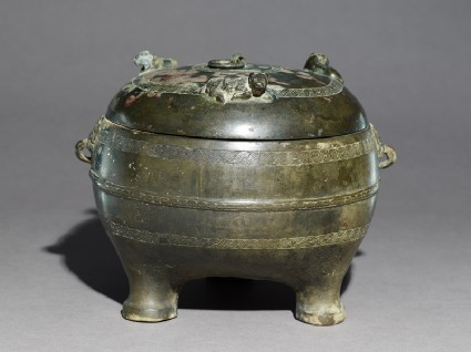 Ritual food vessel, or ding, with seated ox on the lidoblique
