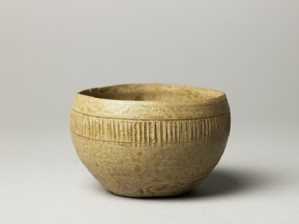 Greenware bowl with ribbed decorationoblique