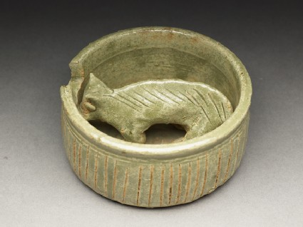 Greenware burial figure of pig in a penoblique