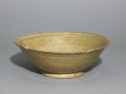 Greenware bowl with foliated rimoblique