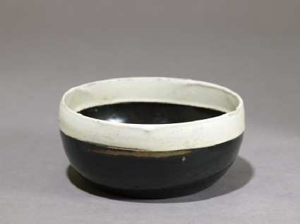 Black ware bowl with white rimoblique