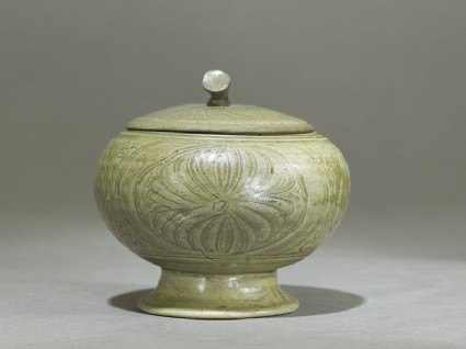 Globular greenware jar with lotus flower decorationside