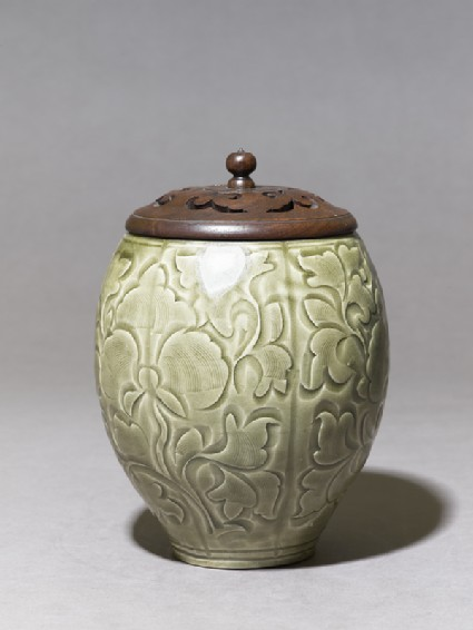 Greenware jar with floral decoration and modern lidside