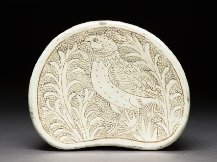 Cizhou type pillow with a bird amid foliagetop