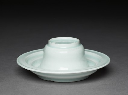 White ware cup and standoblique, front