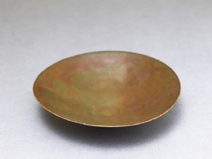 Ding type bowl with russet iron glazeoblique