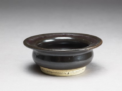 Black ware bowl with iron glazeoblique