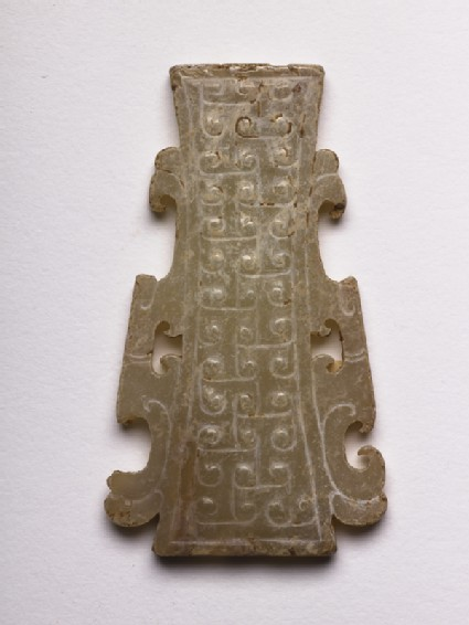 Pendant decorated with interlocking T-scrollsside