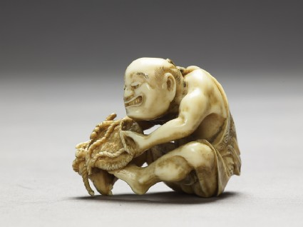 Netsuke in the form of a man making a matside