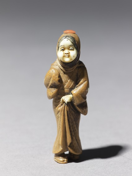 Netsuke in the form of a figure wearing a mask of Okame, a merry Shinto goddessside