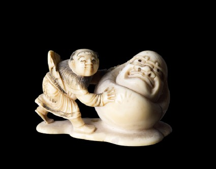 Netsuke in the form of a boy rolling a yuki daruma, or snowmanfront