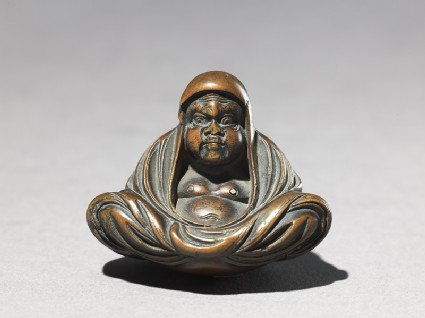 Netsuke in the form of Daruma meditatingfront