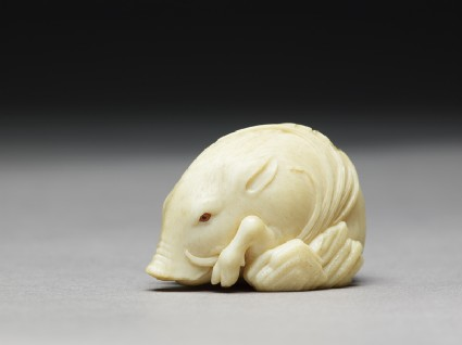 Netsuke in the form of a wild boar among grassside
