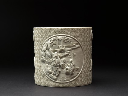 Brush pot with figures in high reliefside